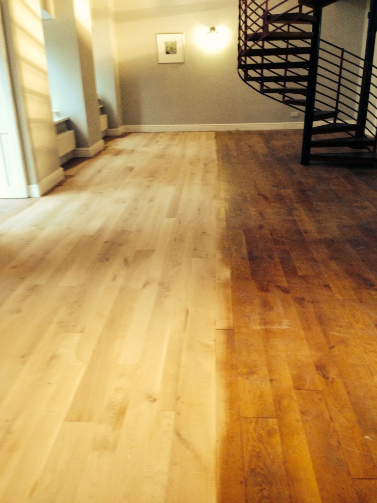 Floor partially sanded, tongue in groove oak boards